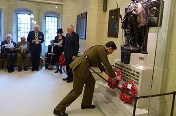 Brigadier Douglas Chalmers DSO OBE lays a wreath on behalf of the Princess of Wales's Royal Regiment 